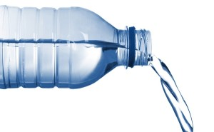 isolated image of bottled water flowing