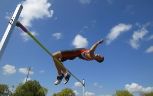 Agile Athlete Completing High Jump Event