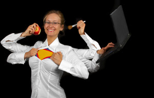 Multitasking woman with multiple arms. The concept of this picture is: multitasking, surplus lifestyle, holding a positive attitude and energy. I am not using the superman logo or trademark, and have just put it there to illustrate the concept. It should be possible to put any name or text at the center of her shirt. This picture is meant for at black or dark background.